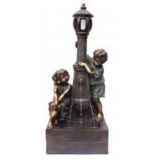Playful Boy & Girl at Lamp
