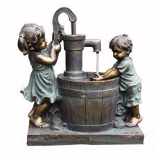 Boy & Girl at Barrel